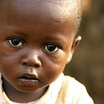 Close-up of an African boy looking at the camera.