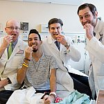Jeremy Davis, Joel Rodriguez, Jonathan Hernandez and Adam Cerise celebrate Joel's successful surgery with burgers and fries.