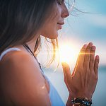 A closeup of a woman meditating