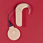 A cochlear implant on top of a red background