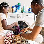 A father and daughter doing laundry with a low noise rated washing machine