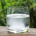 A glass of water with a dissolving effervescent tablet inside