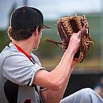 A man pitching a baseball.