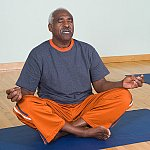 A man practicing yoga.