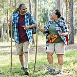 A mature couple hiking together