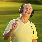 A mature man with headphones on