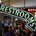 "A neon sign that says ""Restrooms"""