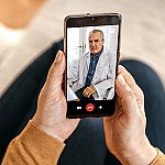 A patient having a video session with a doctor