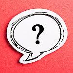A question mark inside of a speech bubble