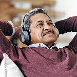 A senior man wearing headphones