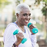 A senior woman exercising with hand weights