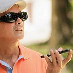 A vision impaired man using a smartphone app
