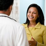 A woman talking with a doctor
