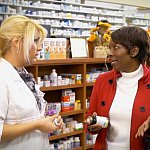 Woman talking with her pharmacist.