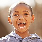 A young boy with a big smile