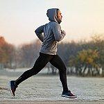 A young man jogging at dawn
