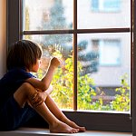 A boy looking out the window.