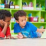 Preschoolers reading a book.