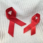 Image of two HIV awareness ribbons