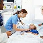 Image of a young girl in a hospital bed.