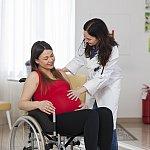 Pregnant woman in a wheelchair.