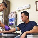 Patient receiving blood draw.