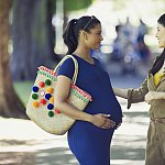 A pregnant woman in the park
