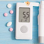 Image of a glucose monitor and pills
