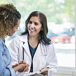 Image of a woman talking with doctor.