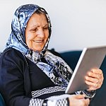 Older woman looking at a tablet