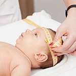 Baby getting head measured