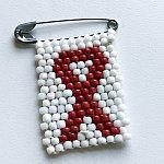 Image of an HIV awareness ribbon pin