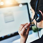 Image of woman answering calls in a call center