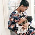 A mother breastfeeding.