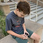 Image of a child reading data on his artificial pancreas device