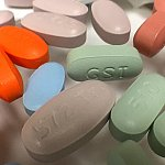 Close-up of a variety of antiretroviral drug tablets
