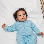 Portrait of a cute baby boy wearing pajamas - stock photo