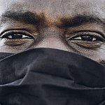 Black man wearing face mask during COVID.