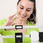 Photo of woman on a scale - cropped