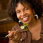 photo of a happy woman eating salad - cropped