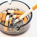 Photo of ashtray filled with cigarette stubs