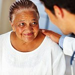 Woman listening to doctor.