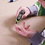 Teen boy checking blood sugar