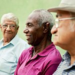 Senior men sitting in the park.