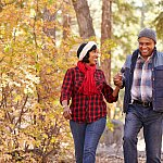 Senior African American couple walking through the woods