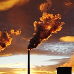 Smoke from coal power plant at sunset