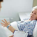 Older woman in hospital bed