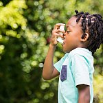Child using an asthma inhaler