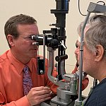 Doctor and participant in eye exam