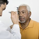 African American man getting eye exam